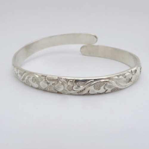 Carved with vine and flower design.