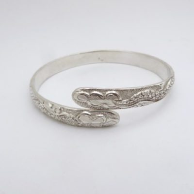 Very solid hand-carved fine silver bangle. Simply bend to take on or off and to adjust size.